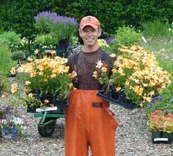 Brad McDonald holding plant in the nursery